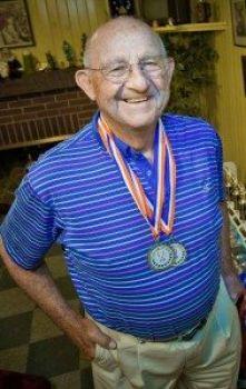 Knee surgery gets Senior Olympics athlete back on the track