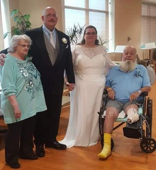 Newlyweds pose with Kimberly's parents.