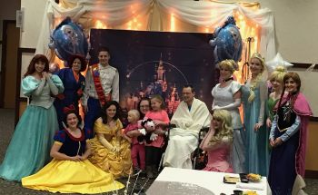 Reid team, volunteers bring Disney experience to hospice patient's family