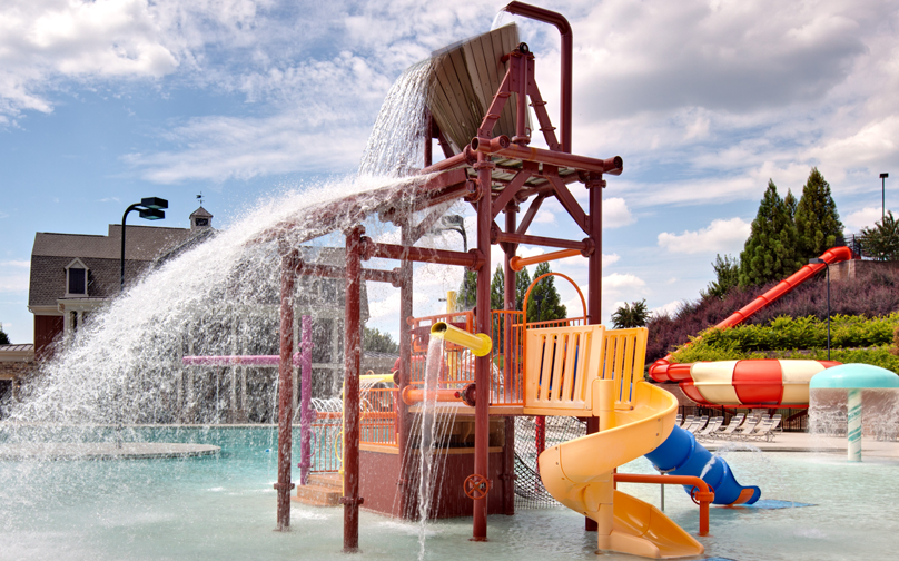 a water playground in the middle of the community pool