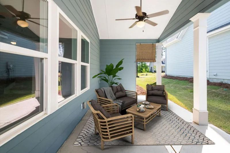 a back patio with furniture and a ceiling fan
