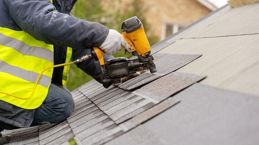 Roofer Repairing Roof