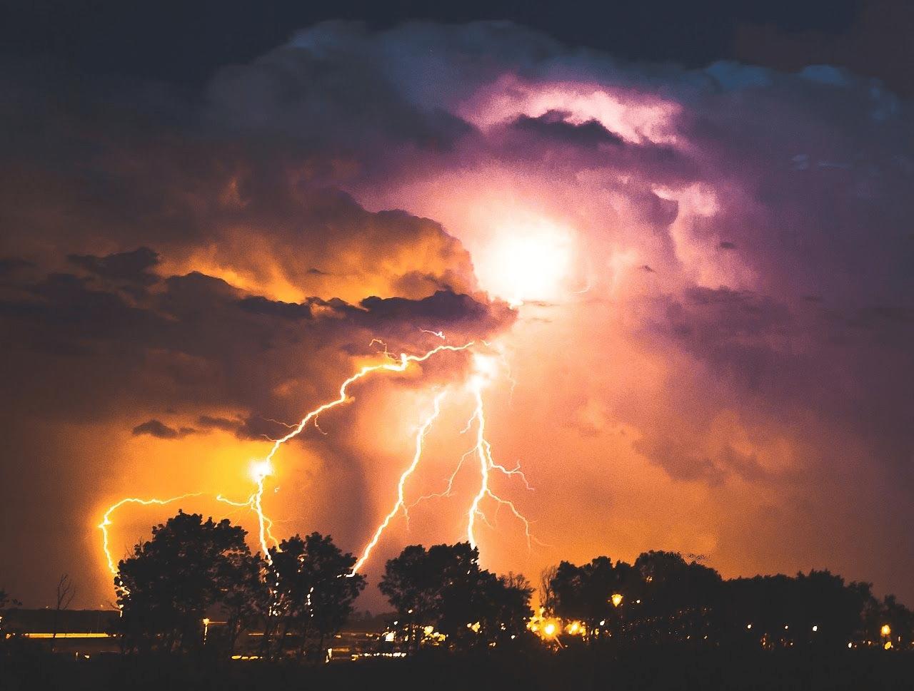 lightning strike over lake at night