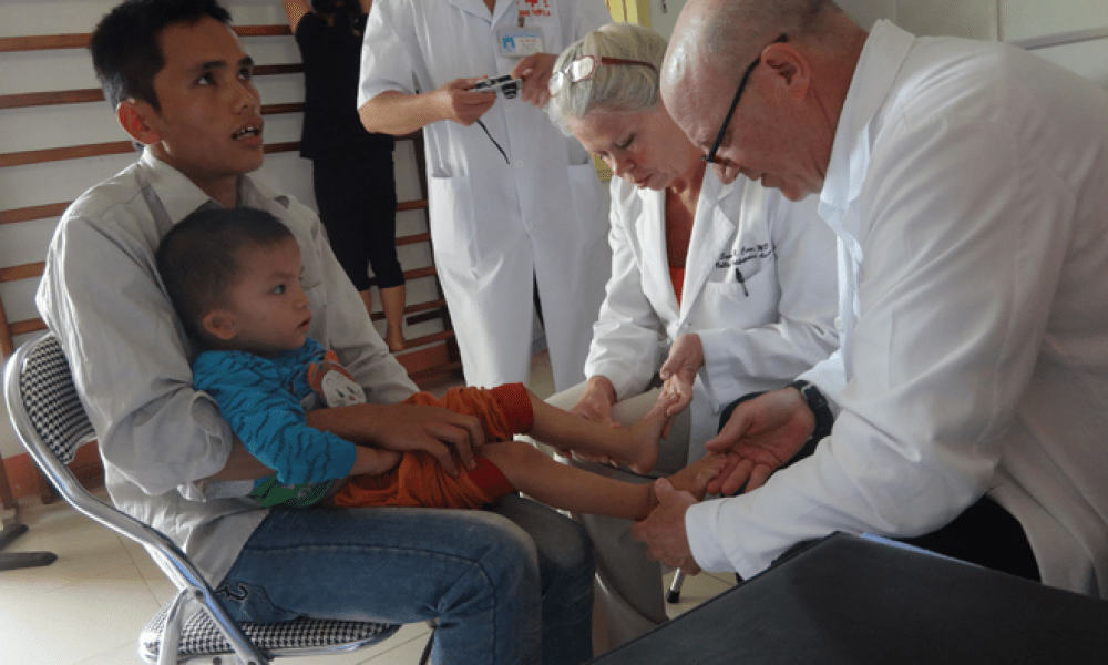 Dr. Veith checks a patient while in Vietnam