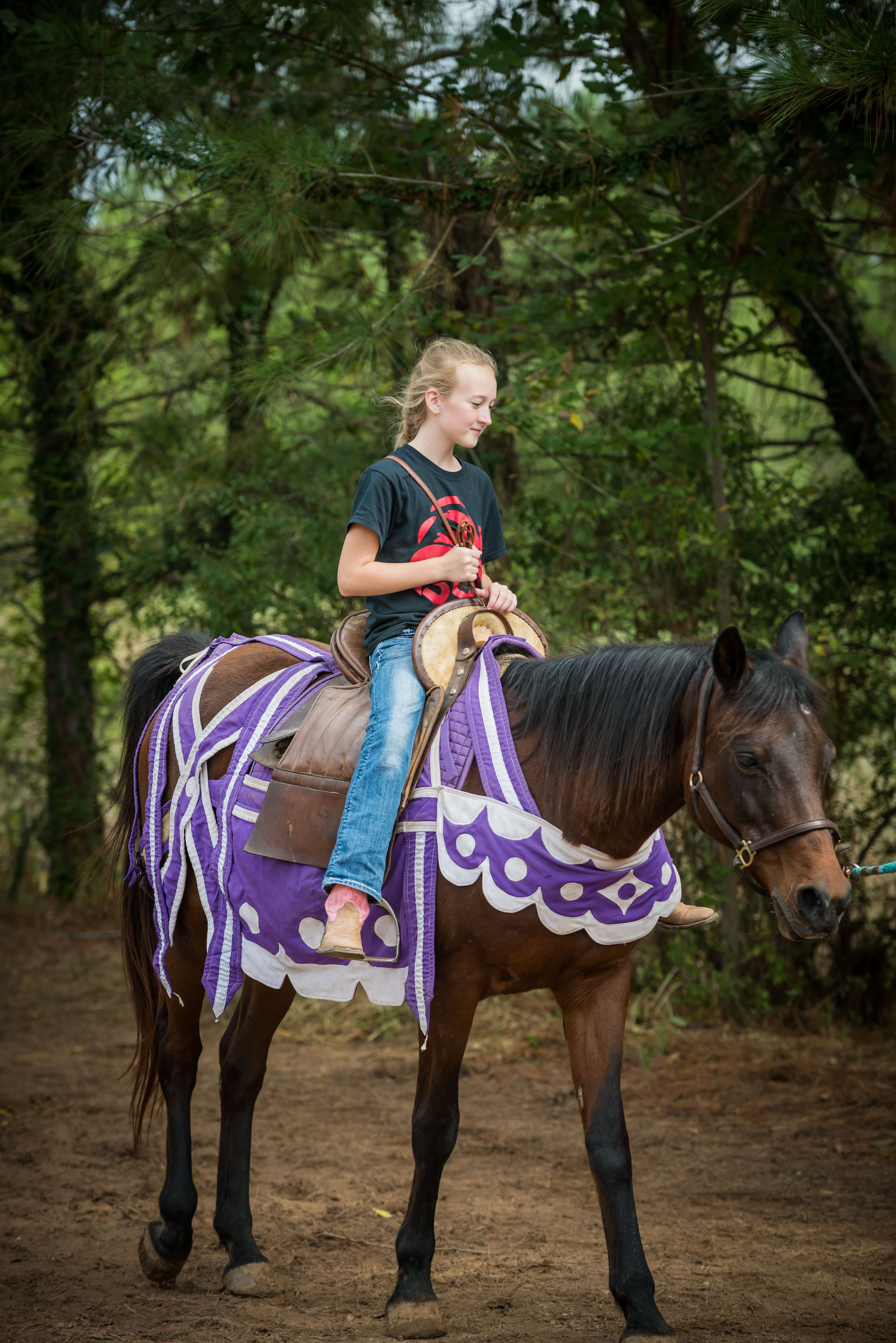 A student has an opportunity to ride near the Joust Arena.