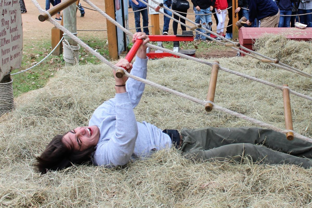 JACOB'S LADDER. Trying his best to make it to the top, senior Kellen Hogan hits the hay again. Ren Fest provides elephant rides, swings, games, and amazing food. (2nd place Feature, Banks Jackson, Willis HS)