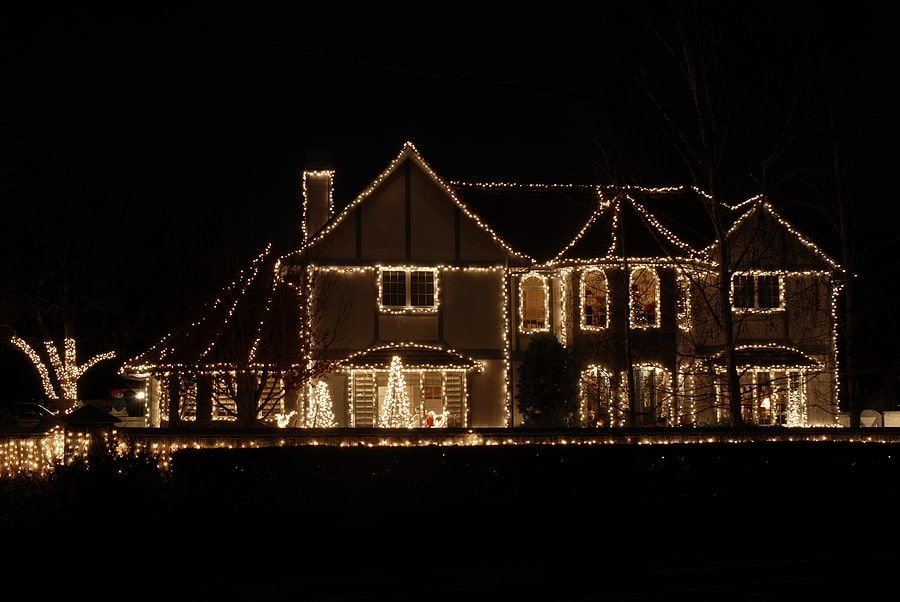 Large house with white christmas lights