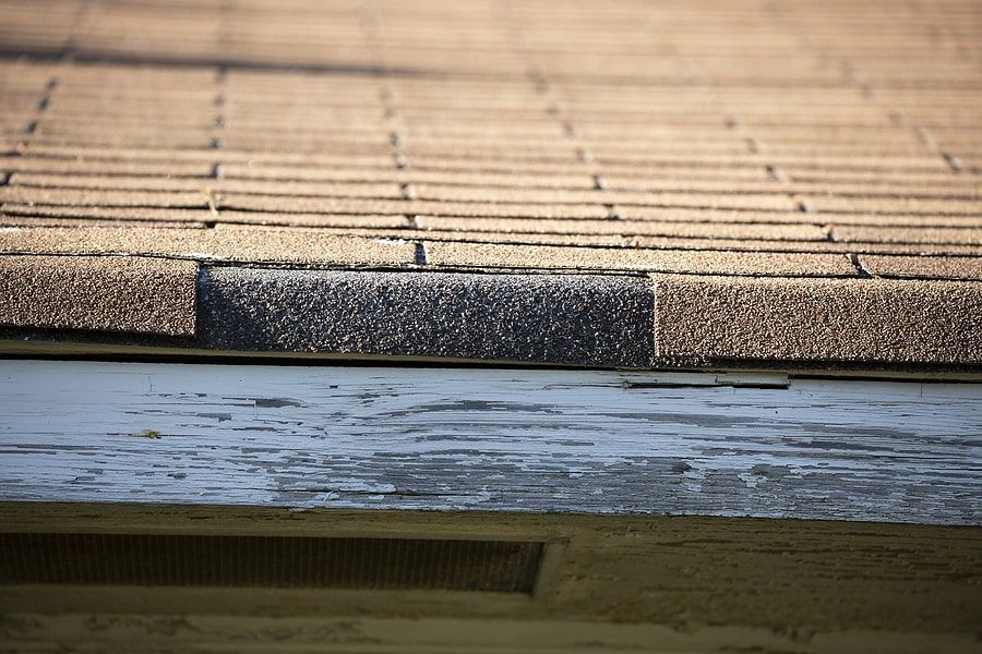 A shingle missing on top of a roof