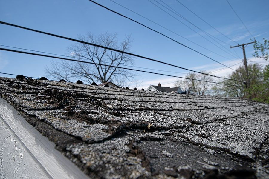 Damaged shingles on top of a roof