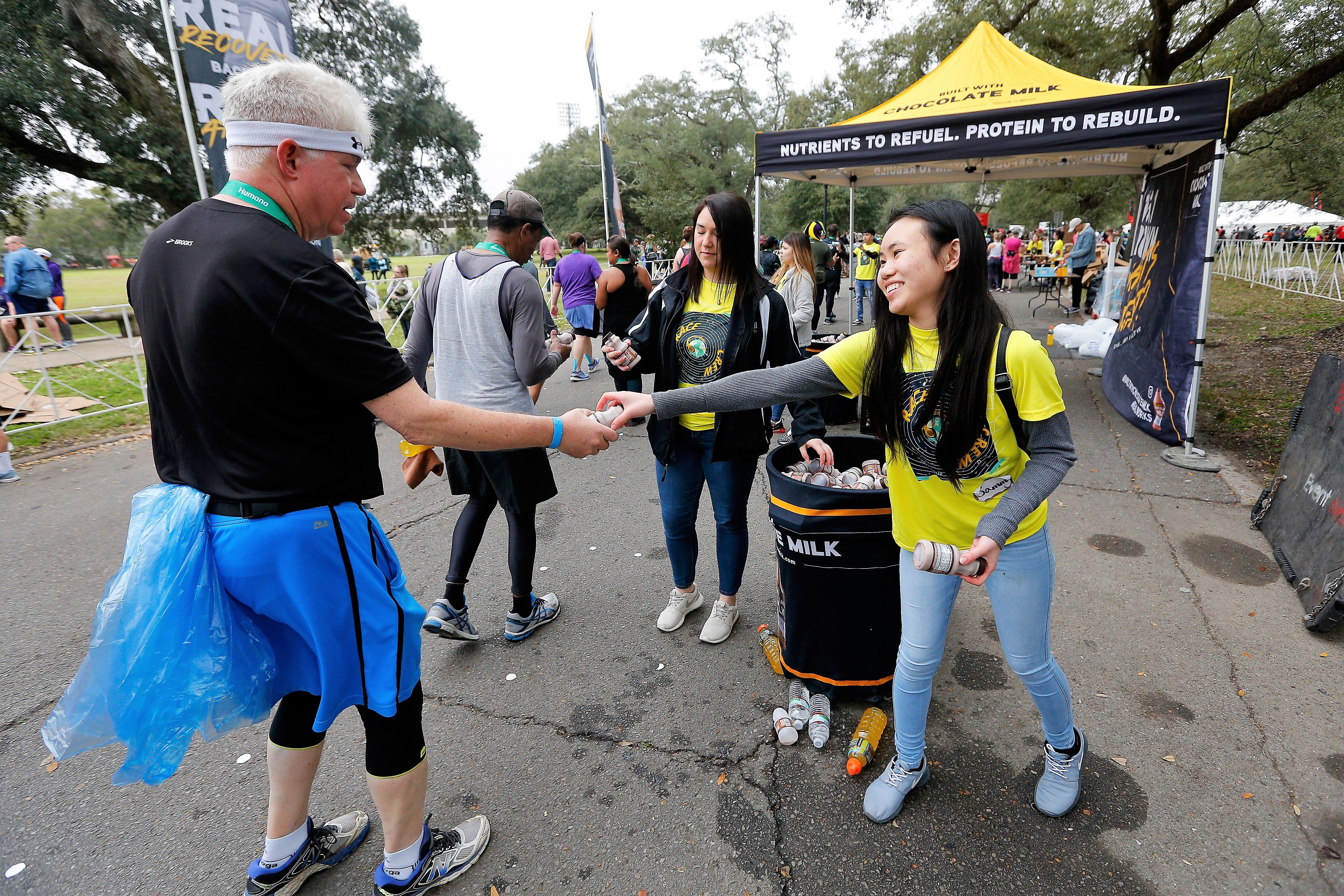 Volunteers Passing out Chocolate Milk to Runners