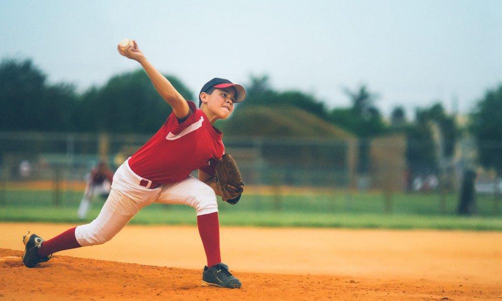boy pitches baseball