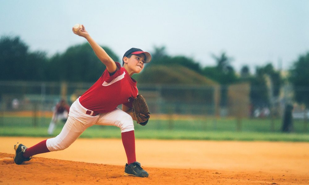 boy pitches baseball