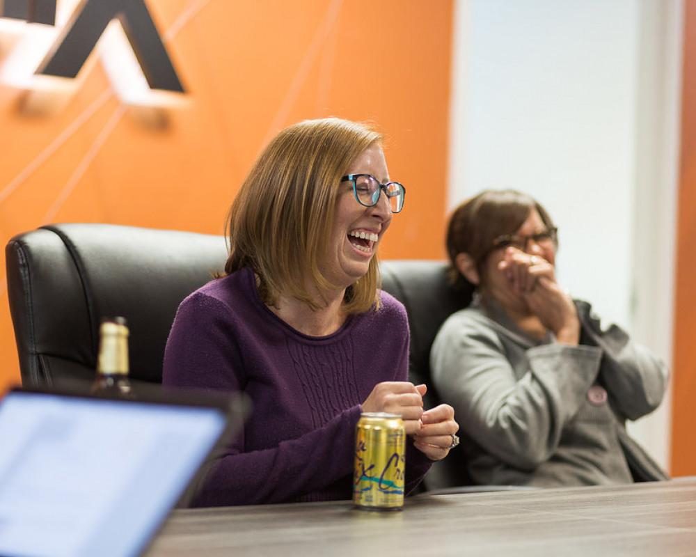 Team members laughing