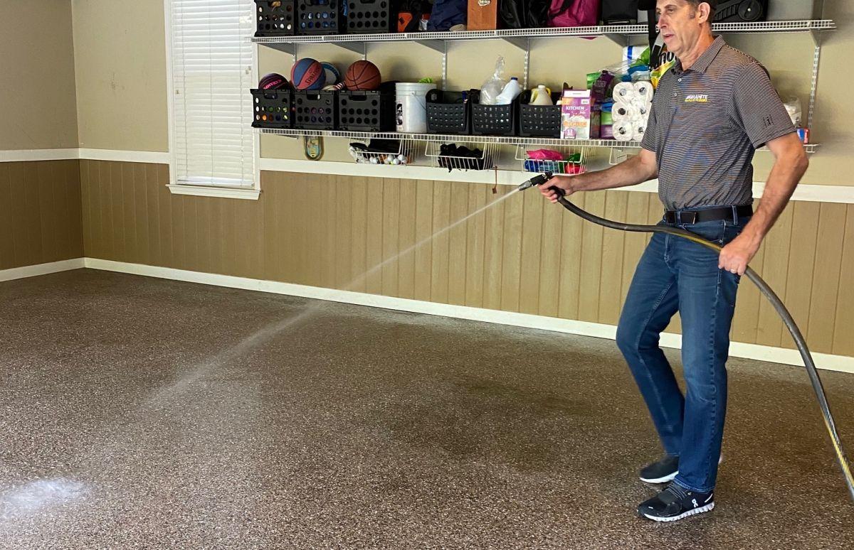Generously apply water to the garage floor