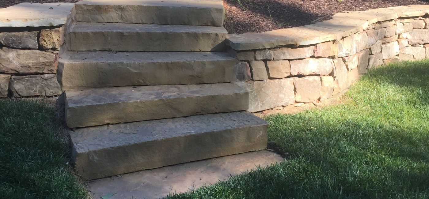 Stone treads, brown stone bolder wall