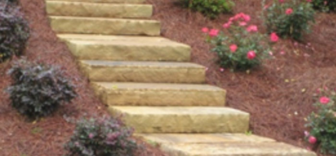 Brown stone step treads in landscape