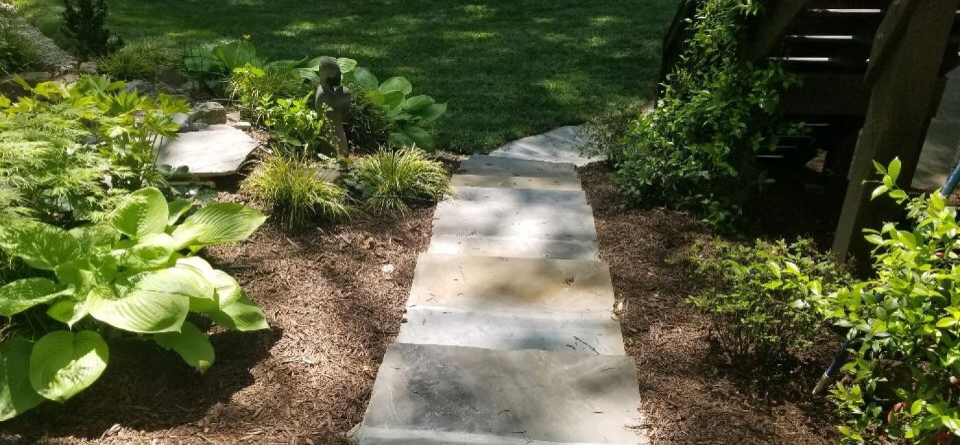 New sod with stone step pathway installed
