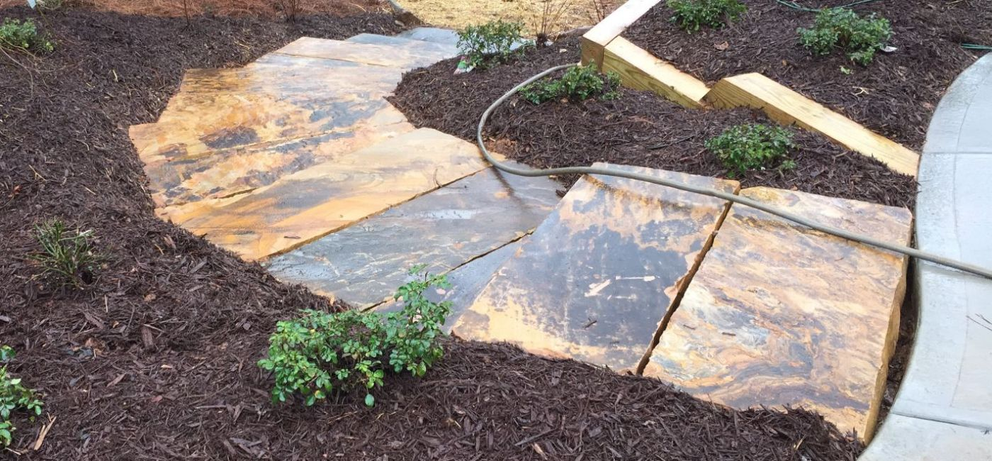 Brown stone stair treads in landscape