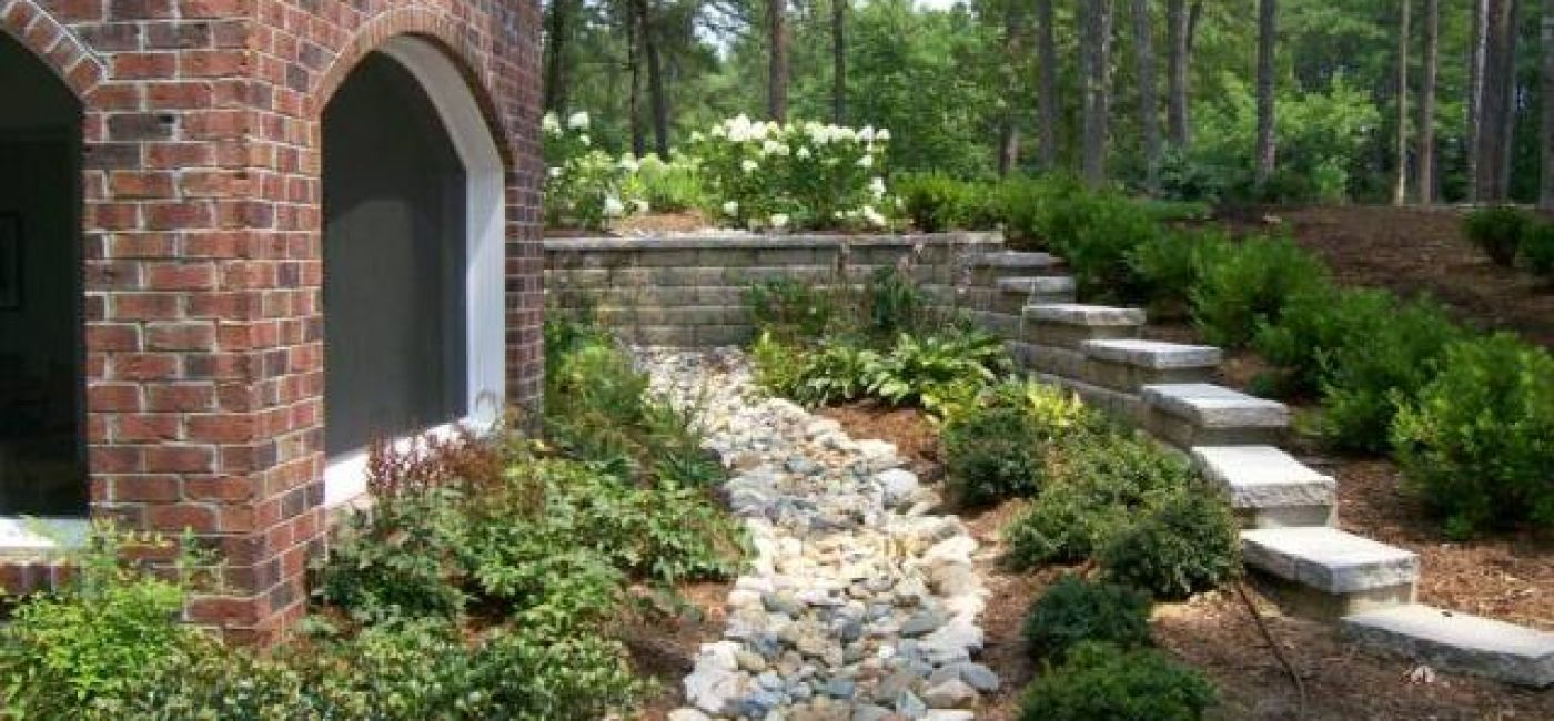 deco creek bed, in landscape, side of house