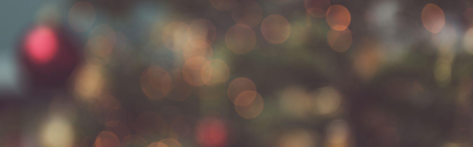 Blurred Christmas lights on evergreen tree