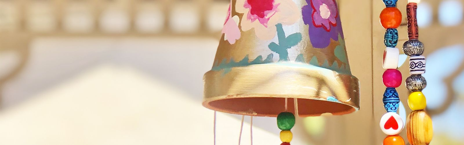 a close up of flower pot wind chime