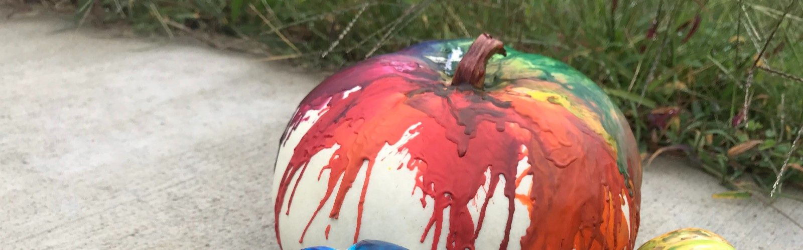 white pumpkins covered with melted crayon wax