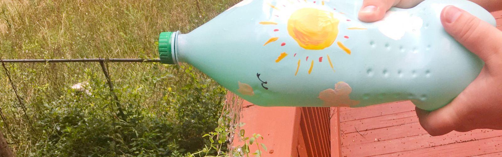 soda bottle watering can