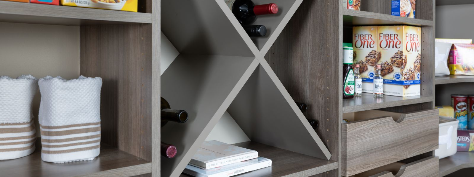 a pantry with wine racks and baskets