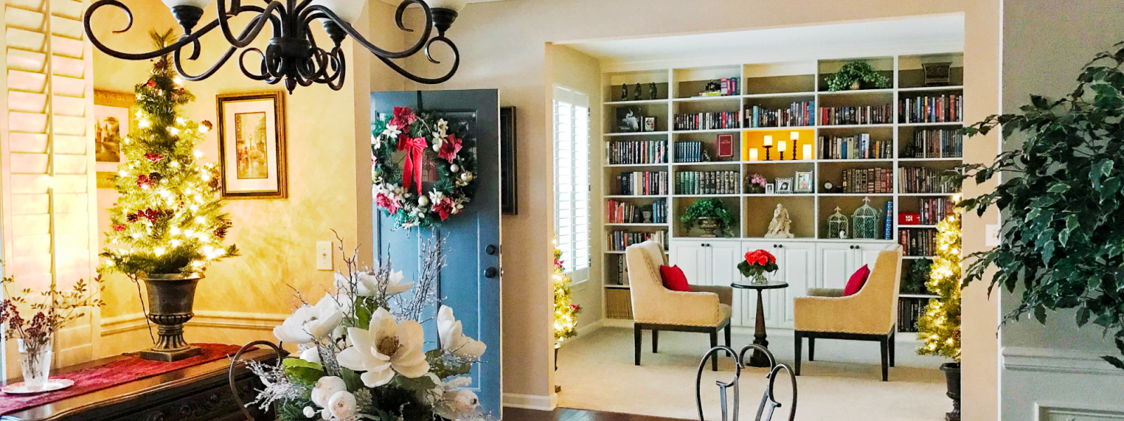a living room filled with holiday decorations