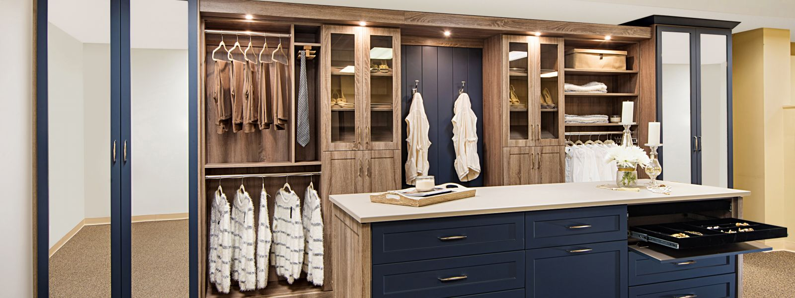 a custom closet with blue accents