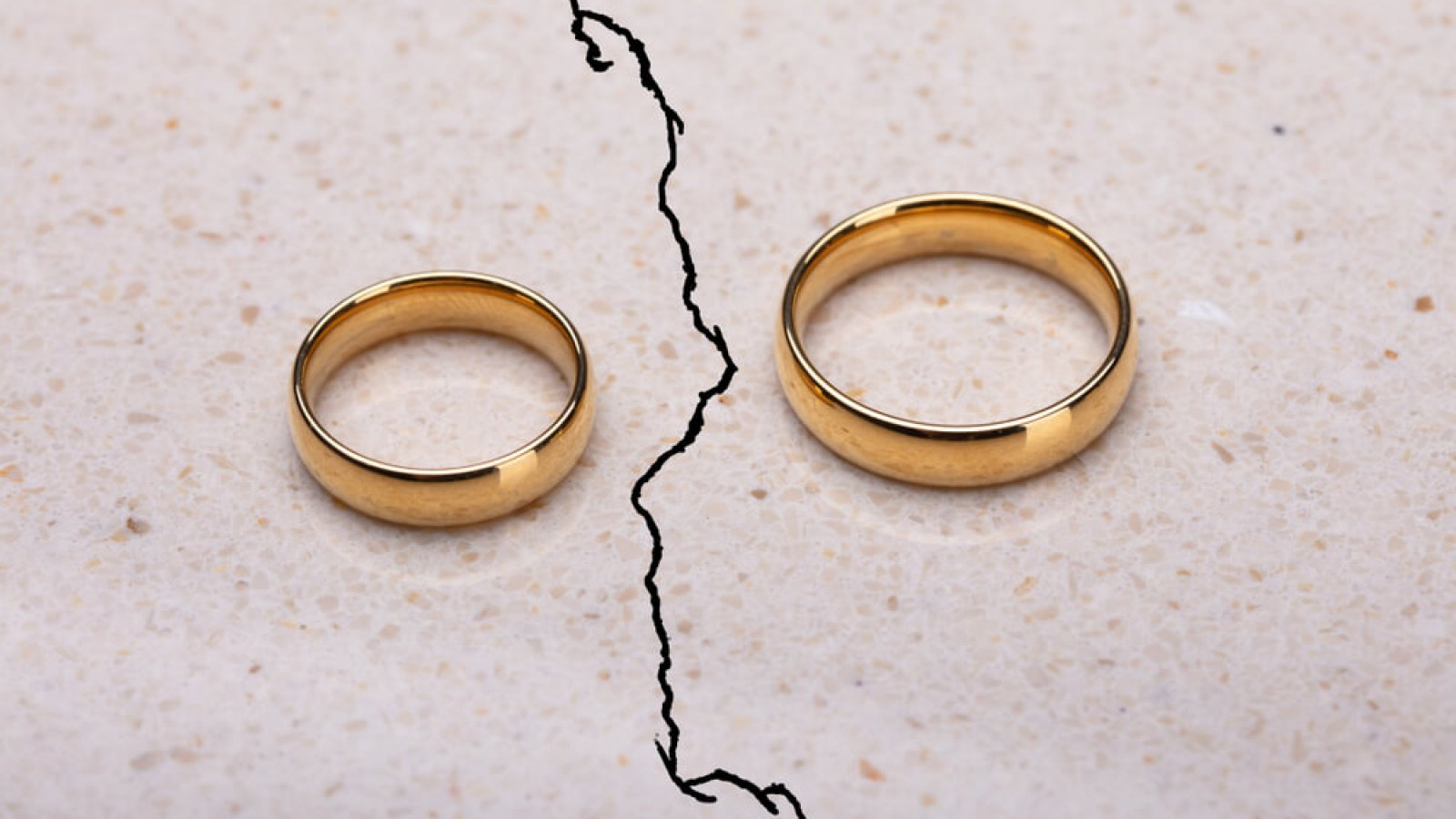 Two weddings runs separated by a crack in concrete