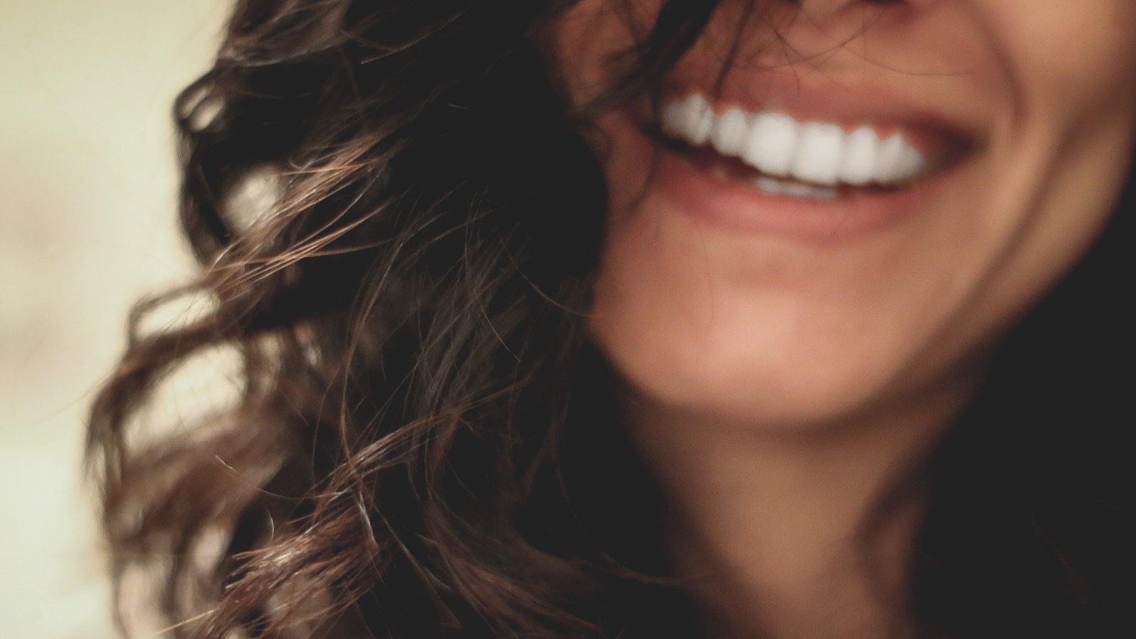a close up of a woman smiling at the camera