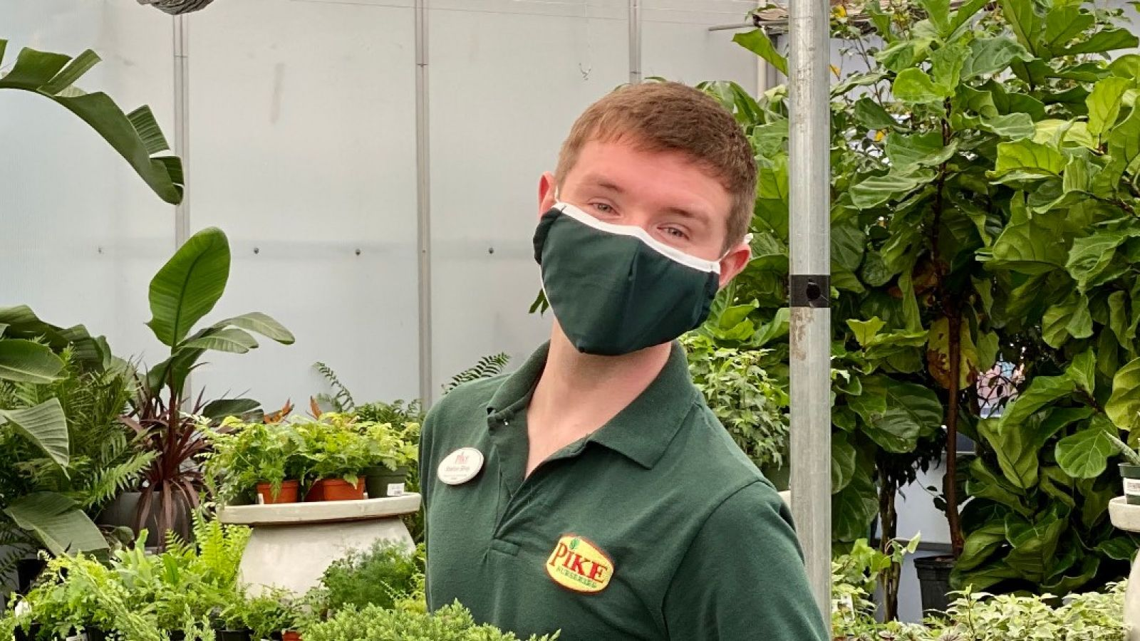 pike nurseries employee in a mask