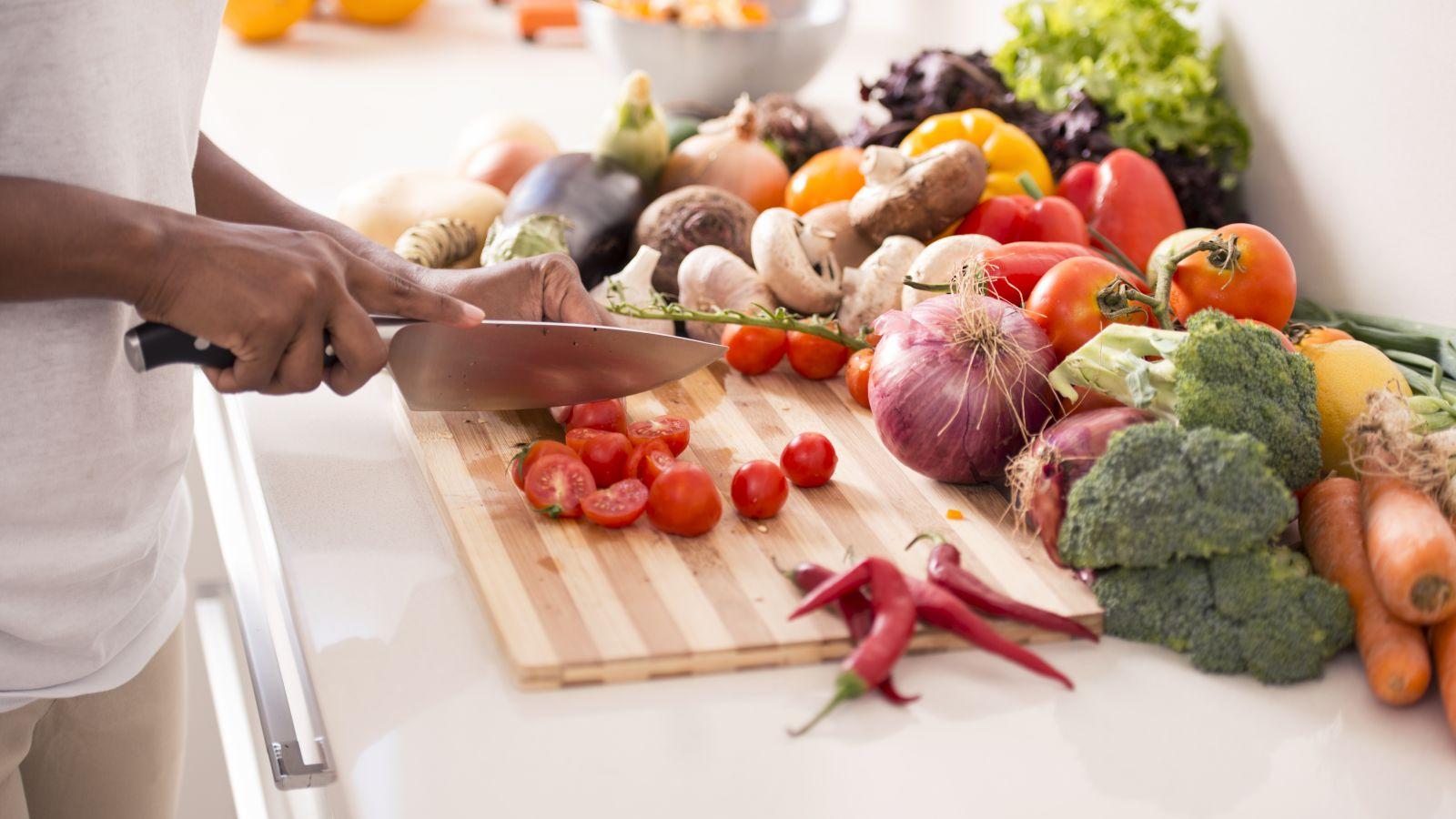 woman chopping fresh vegetables