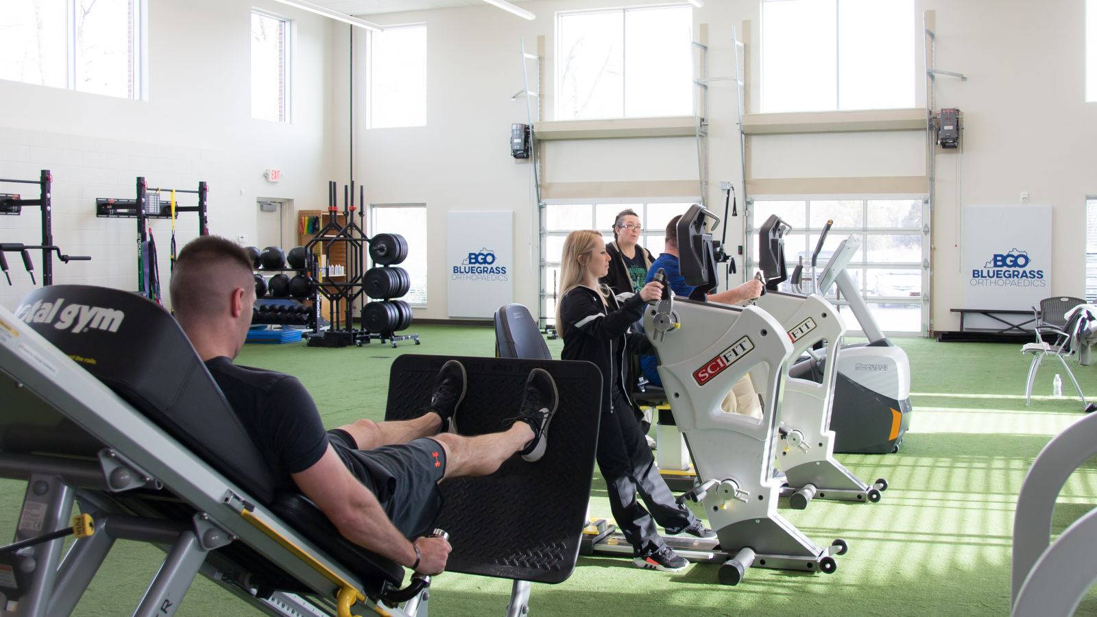 a person sitting on an exercise machine