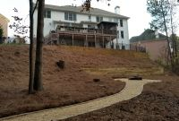 Pager Link for Pea-gravel pathway with timber retaining wall and fire pit.