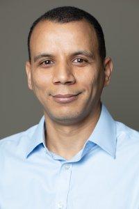 Adil Amou headshot