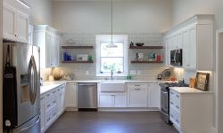 Thumbnail control image for a white refrigerator freezer sitting inside of a kitchen