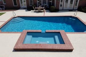 In-Ground Pool With Spillover Spa Maintained By Brown's Pools & Spas