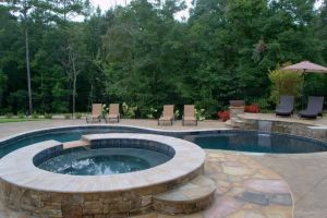 Gunite Pool with custom decking/spillover spa
