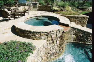 Gunite Pool with elevated spillover spa