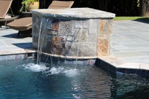 Water Feature that spills into gunite pool