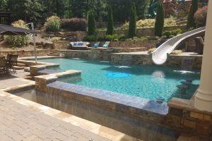 Vanishing Edge Pool W/Slide maintained by Brown's Pools & Spas
