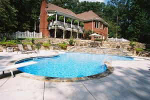 Freeform Vinyl Pool With Custom Stone Decking