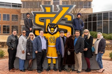 The Exploring, Inc. team with the Kennesaw State logo sculpture crafted by the ID3 Group team