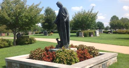 a statue of a man in a garden