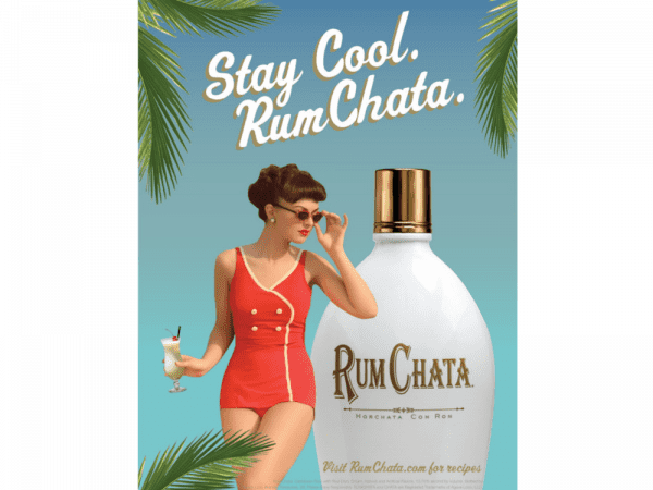 rumchata print magazine advertisement showing woman holding a cocktail surrounded by palm trees
