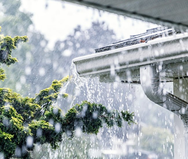 <strong>Rain spilling</strong> over the <strong>top</strong> of gutters? image