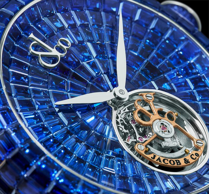 a large blue clock sitting on top of a watch