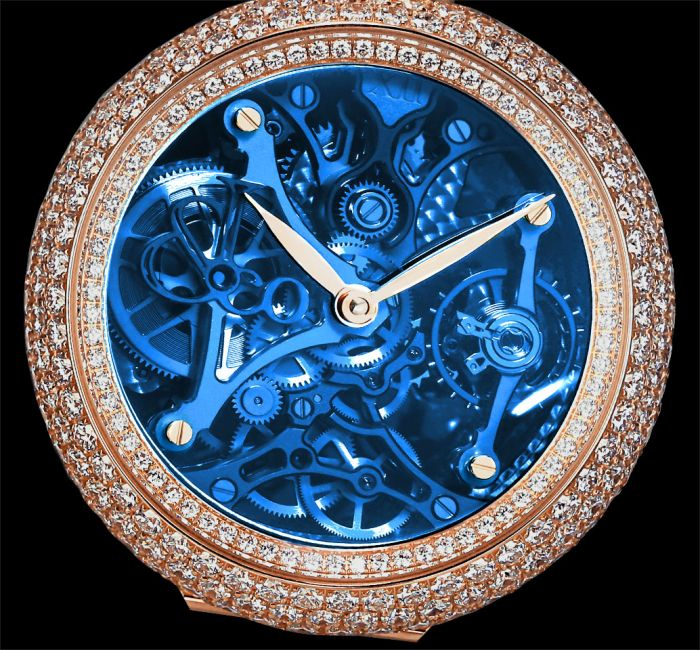 a blue clock sitting on the ground